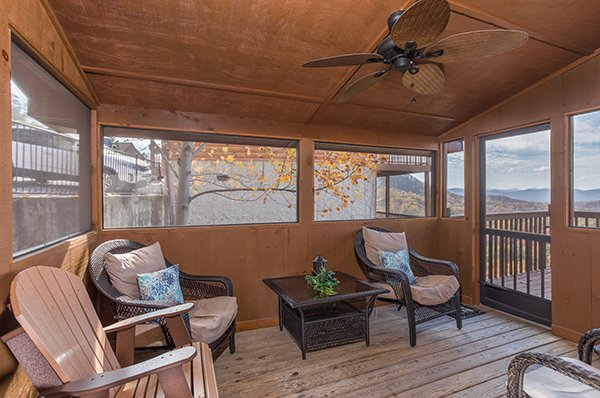 Screened porch with three chairs at The Bear's House, a 4 bedroom cabin rental in Pigeon Forge