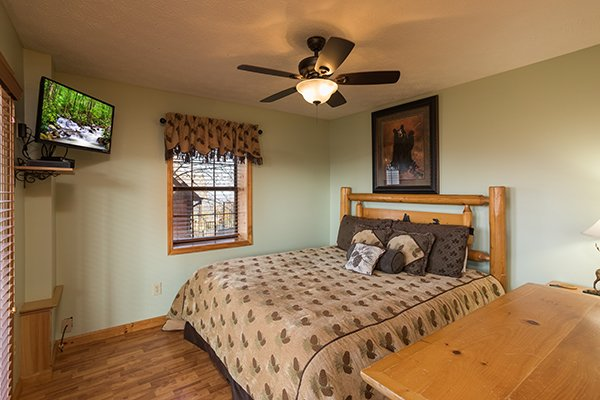 King bedroom with a dresser and TV at The Bear's House, a 4 bedroom cabin rental in Pigeon Forge