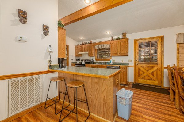 Breakfast bar with seating for two at Pampered Campers, a 3 bedroom cabin rental located in Pigeon Forge