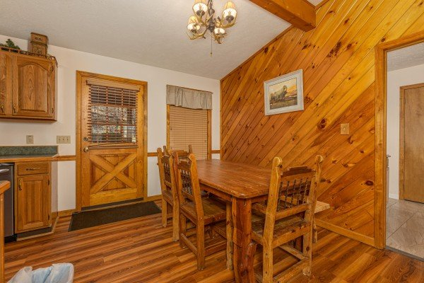 Dining table for six at Pampered Campers, a 3 bedroom cabin rental located in Pigeon Forge