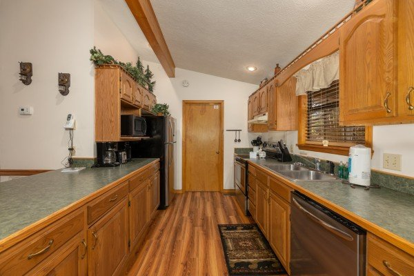 Galley kitchen at Pampered Campers, a 3 bedroom cabin rental located in Pigeon Forge