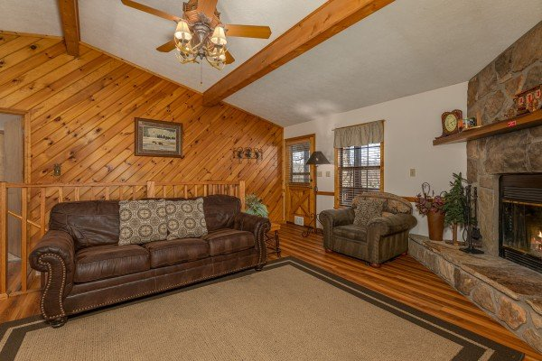 Sofa and chair in the living room at Pampered Campers, a 3 bedroom cabin rental located in Pigeon Forge