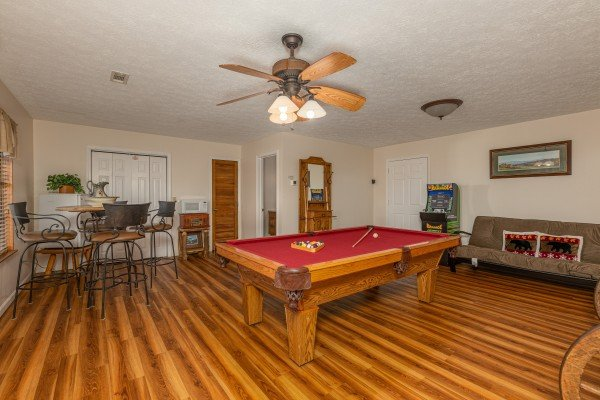 Pool table in the lower level at Pampered Campers, a 3 bedroom cabin rental located in Pigeon Forge