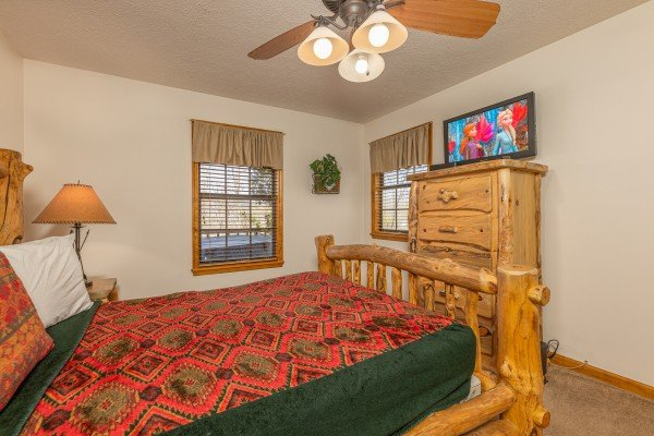 Dresser and TV in a bedroom at Pampered Campers, a 3 bedroom cabin rental located in Pigeon Forge
