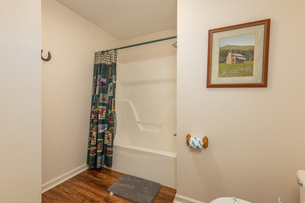Tub and shower in a bathroom at Pampered Campers, a 3 bedroom cabin rental located in Pigeon Forge