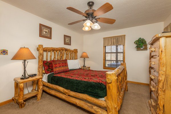 Bedroom with a dresser and TV at Pampered Campers, a 3 bedroom cabin rental located in Pigeon Forge