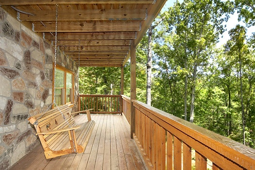 first floor deck with swing at smoky bears creek a 2 bedroom cabin rental located in pigeon forge