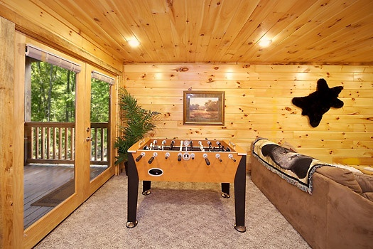 foosball table on first floor at smoky bears creek a 2 bedroom cabin rental located in pigeon forge