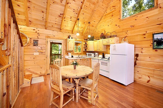 kitchen and dining room at smoky bears creek a 2 bedroom cabin rental located in pigeon forge