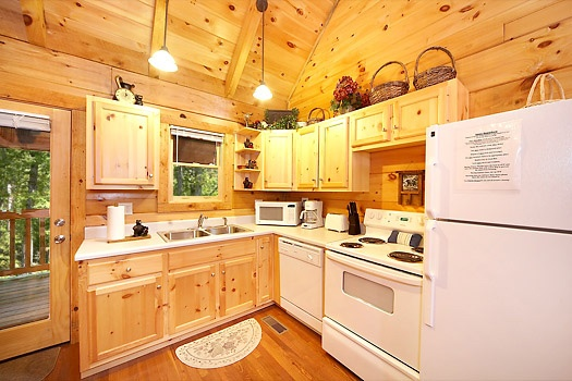 kitchen area at smoky bears creek a 2 bedroom cabin rental located in pigeon forge