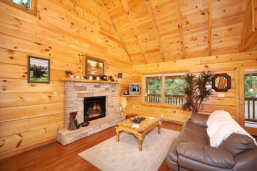 living room with fireplace at smoky bears creek a 2 bedroom cabin rental located in pigeon forge