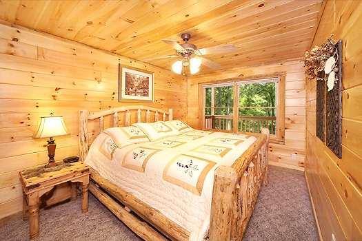 lower level king bedroom at smoky bears creek a 2 bedroom cabin rental located in pigeon forge