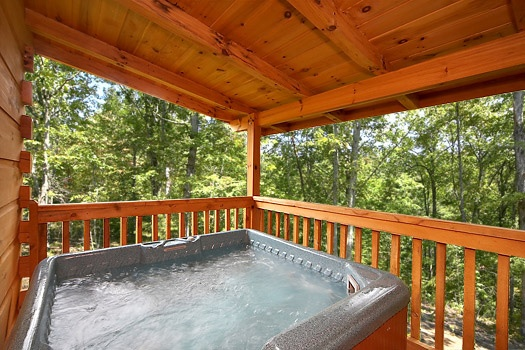 main level deck with hot tub at smoky bears creek a 2 bedroom cabin rental located in pigeon forge