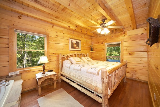main level king bedroom at smoky bears creek a 2 bedroom cabin rental located in pigeon forge