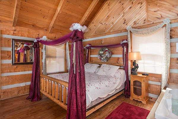 Four post bed in the studio setting at Bare Hugs, a 1-bedroom cabin rental located in Pigeon Forge