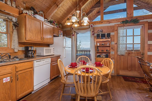 Kitchen and dining room with seating for four Bare Hugs, a 1-bedroom cabin rental located in Pigeon Forge