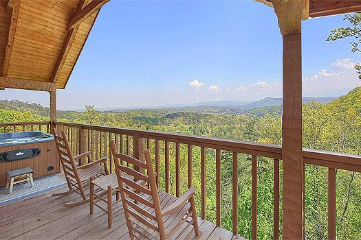 Rocking chairs on the deck at Bare Hugs, a 1-bedroom cabin rental located in Pigeon Forge