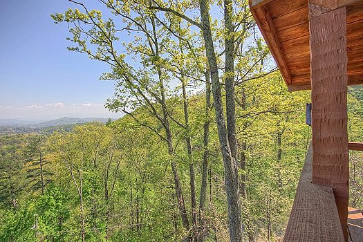 View of the Smoky Mountain horizon from deck at Bare Hugs, a 1-bedroom cabin rental located in Pigeon Forge