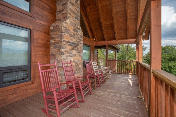 Rocking chairs on a covered deck at Cedar Creeks, a 2-bedroom cabin rental located near Douglas Lake