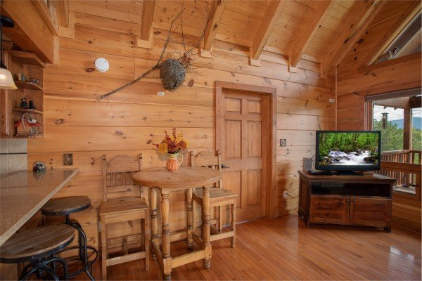 Dining space shared with the living room at Cedar Creeks, a 2-bedroom cabin rental located near Douglas Lake