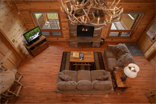 Living room and antler chandelier from above at Cedar Creeks, a 2-bedroom cabin rental located near Douglas Lake