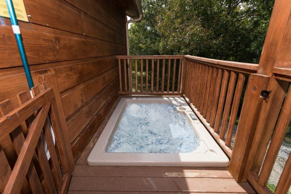 Sunken hot tub on a deck at Cedar Creeks, a 2-bedroom cabin rental located near Douglas Lake