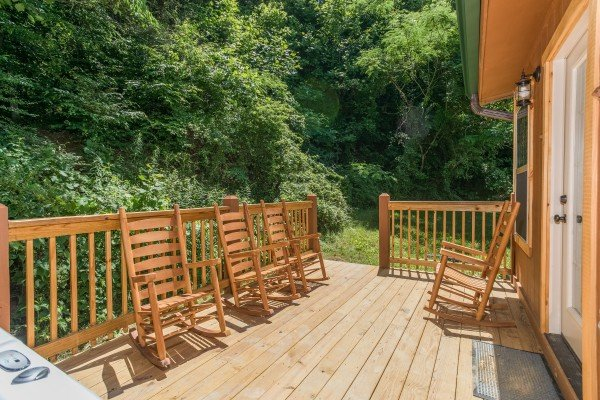 Deck with rocking chairs at Grill & Chill, a 2-bedroom Gatlinburg cabin rental