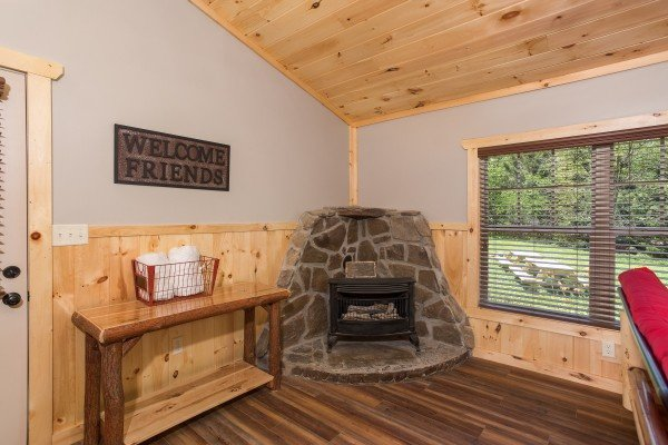 Corner gas fireplace in the living room at Grill & Chill, a 2-bedroom Gatlinburg cabin rental