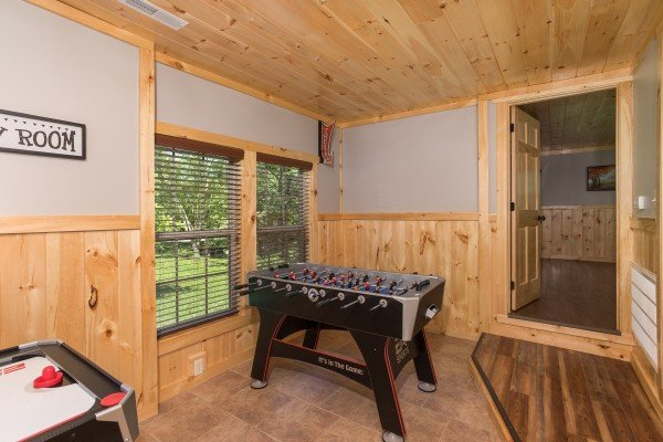 Foosball table in a game room at Grill & Chill, a 2-bedroom Gatlinburg cabin rental