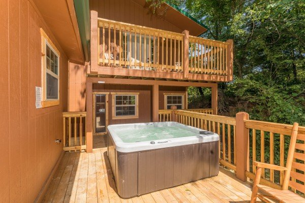 Hot tub on a deck with wooded views at Grill & Chill, a 2-bedroom Gatlinburg cabin rental
