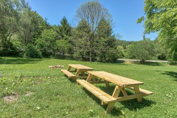 Two picnic tables near the horseshoe pit at Grill & Chill, a 2-bedroom Gatlinburg cabin rental