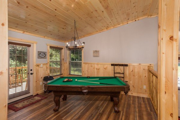 Pool table in the room off the kitchen at Grill & Chill, a 2-bedroom Gatlinburg cabin rental