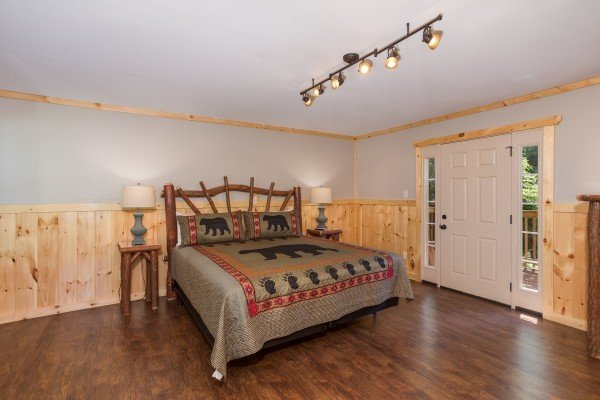 Bedroom with a king-sized bed and outdoor access at Grill & Chill, a 2-bedroom Gatlinburg cabin rental