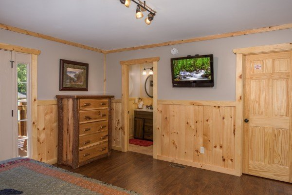 Dresser and TV in the second floor bedroom at Grill & Chill, a 2-bedroom Gatlinburg cabin rental