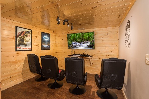 Game room with multiple video game systems at Grill & Chill, a 2-bedroom Gatlinburg cabin rental
