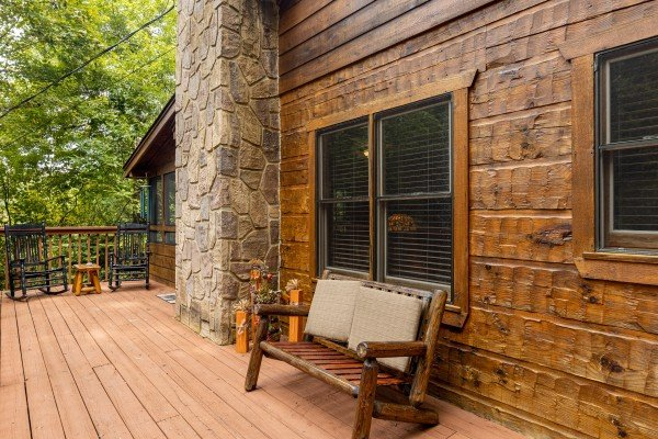 Bench on a deck at Sweet Caroline, a 2 bedroom cabin rental located in Pigeon Forge