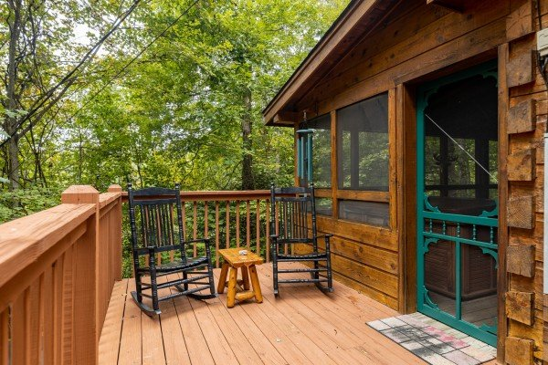 Rocking chairs on a deck at Sweet Caroline, a 2 bedroom cabin rental located in Pigeon Forge