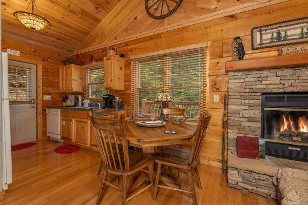 Dining table for four at Sweet Caroline, a 2 bedroom cabin rental located in Pigeon Forge