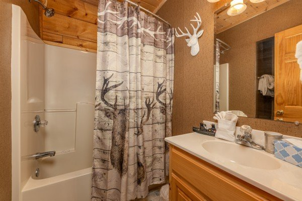 Bathroom with a tub and shower at Sweet Caroline, a 2 bedroom cabin rental located in Pigeon Forge
