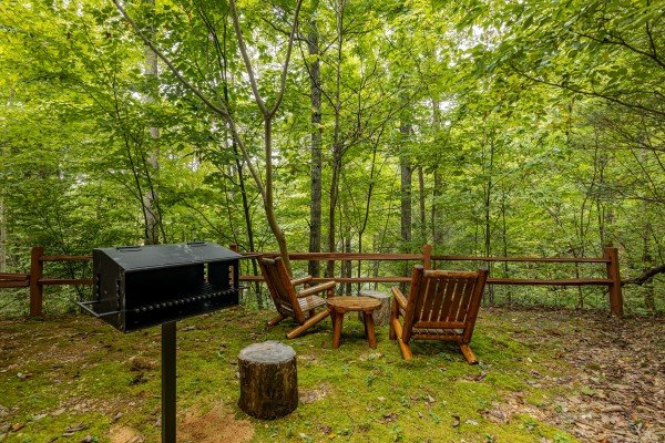 Grill and chairs in the yard at Sweet Caroline, a 2 bedroom cabin rental located in Pigeon Forge