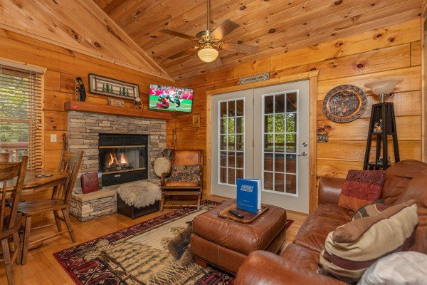 Living room with fireplace and TV at Sweet Caroline, a 2 bedroom cabin rental located in Pigeon Forge