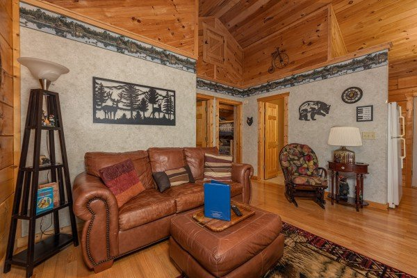 Sofa in a living room at Sweet Caroline, a 2 bedroom cabin rental located in Pigeon Forge