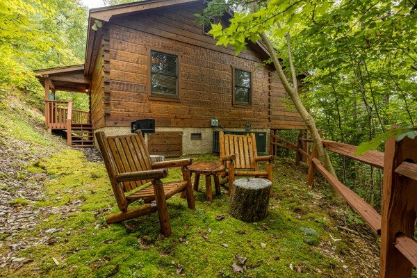 Adirondack chairs in the yard at Sweet Caroline, a 2 bedroom cabin rental located in Pigeon Forge