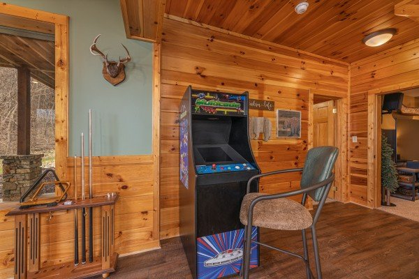 Arcade game in the game room at Lookout Lodge, a 5 bedroom cabin rental located in Pigeon Forge