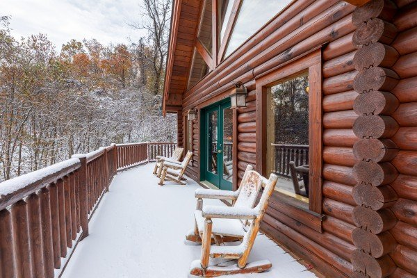 Porch with rocking chairs at Lookout Lodge, a 5 bedroom cabin rental located in Pigeon Forge