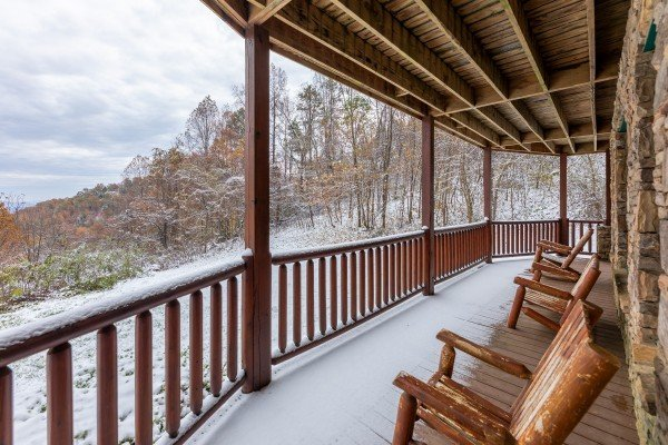 Rocking chairs on a covered deck at Lookout Lodge, a 5 bedroom cabin rental located in Pigeon Forge