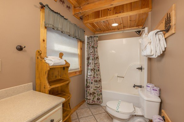 Bathroom with a tub and shower at Lookout Lodge, a 5 bedroom cabin rental located in Pigeon Forge