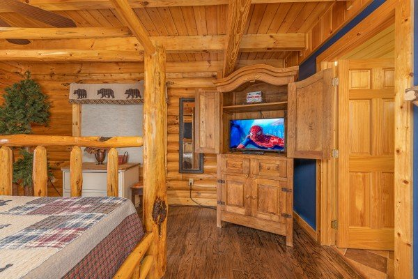 Bedroom with armoire and TV at Lookout Lodge, a 5 bedroom cabin rental located in Pigeon Forge