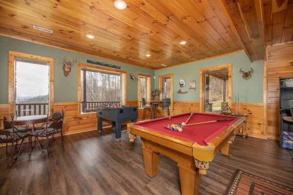 Game room with a pool table, foosball, and arcade game at Lookout Lodge, a 5 bedroom cabin rental located in Pigeon Forge
