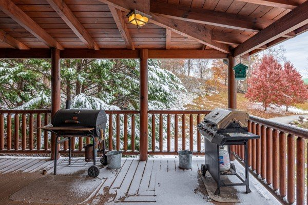 Propane and charcoal grills on a covered porch at Lookout Lodge, a 5 bedroom cabin rental located in Pigeon Forge